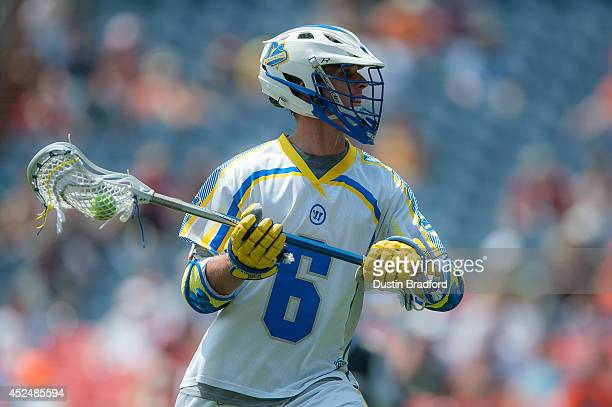 Kieran McArdle of the Florida Launch caries the ball against the Denver Outlaws during a Major League Lacrosse game at Sports Authority Field at Mile...