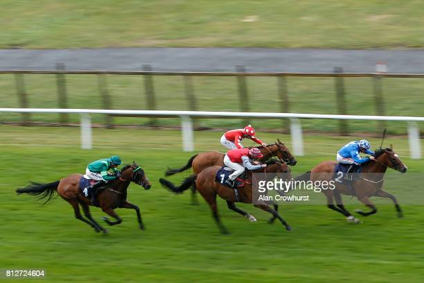 Kieran O'Neill riding Wild Flower win The Earl Kendrick Brighton One Year Celebration Handicap Stakes at Brighton racecourse on July 11 2017 in...