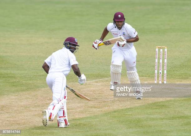 Kieran Powell and Devon Smith of West Indies run between the wickets during the second day of the second Test cricket match between West Indies and...