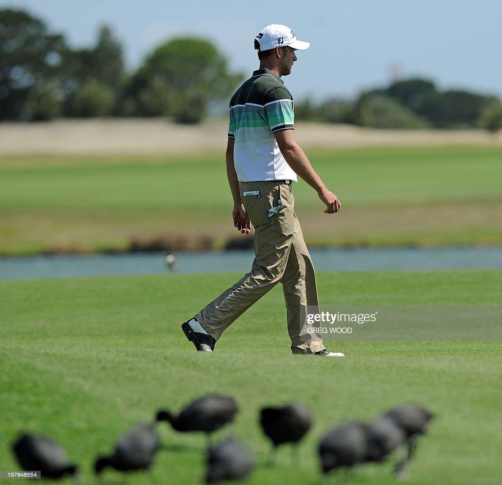 Kieran Pratt of Australia walks past birds on the 17th fairway during round three of the Australian Open golf at The Lakes course in Sydney on December 8, 2012. AFP PHOTO / Greg WOOD USE