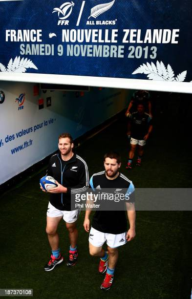 Kieran Read and Dane Coles of the All Blacks walk out of the players tunnel during the New Zealand All Blacks captains run at Stade de France on...