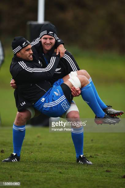 Kieran Read lifts Liam Messam of the All Blacks up during a training session at Peffermill University on November 6 2012 in Edinburgh Scotland