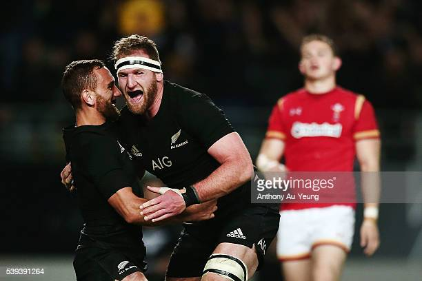 Kieran Read of New Zealand celebrates after scoring a try with teammate Aaron Cruden during the International Test match between the New Zealand All...