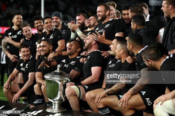 Kieran Read of the All Blacks and team mates celebrate with the Bledisloe Cup after winning The Rugby Championship and Bledisloe Cup Test match...