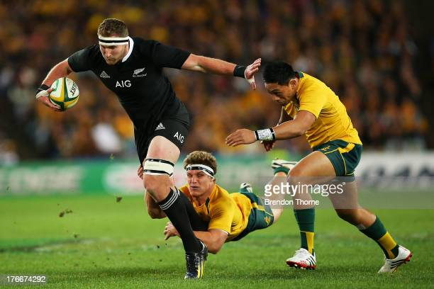 Kieran Read of the All Blacks breaks the tackle of Michael Hooper and Christian Lealiifano of the Wallabies during The Rugby Championship Bledisloe...