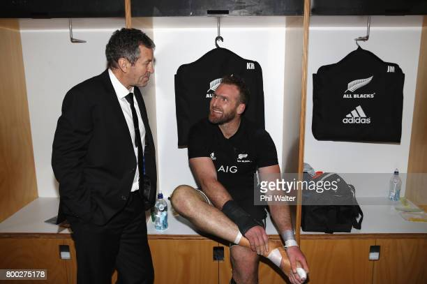 Kieran Read of the All Blacks celebrates with assistant coach Wayne Smith in the dressing room after the first test match between the New Zealand All...