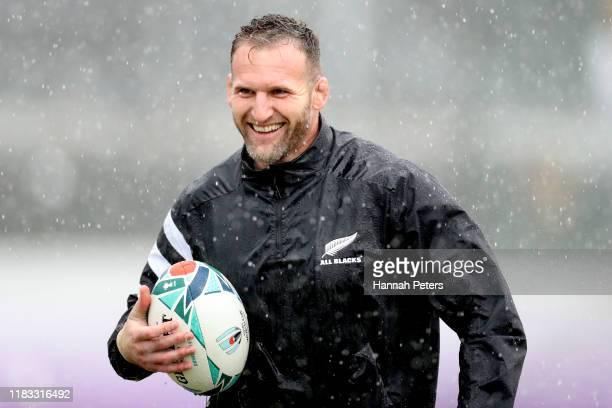 Kieran Read of the All Blacks enjoys the rain during the New Zealand All Blacks captain's run at Tatsuminomori Seaside Park on October 25, 2019 in...