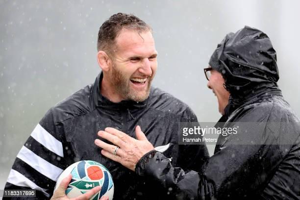 Kieran Read of the All Blacks enjoys the rain with scrum coach Mike Cron during the New Zealand All Blacks captain's run at Tatsuminomori Seaside...