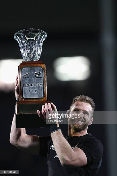 Kieran Read of the All Blacks holds up the Freedom Cup following the Rugby Championship match between the New Zealand All Blacks and the South Africa...