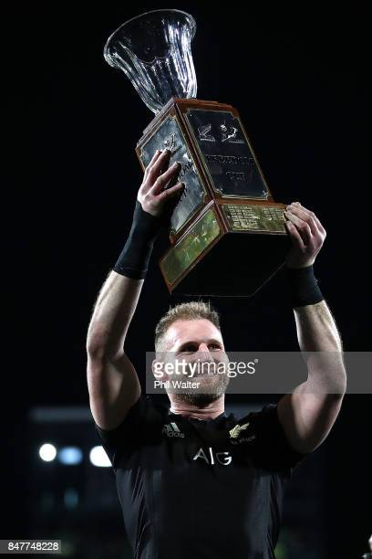 Kieran Read of the All Blacks holds up the Freedom Cup following the Rugby Championship match between the New Zealand All Blacks and the South...
