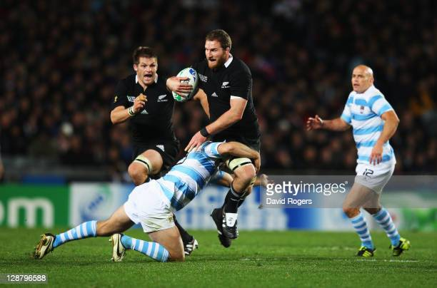 Kieran Read of the All Blacks is tackled by Marcelo Bosch of Argentina during quarter final four of the 2011 IRB Rugby World Cup between New Zealand...