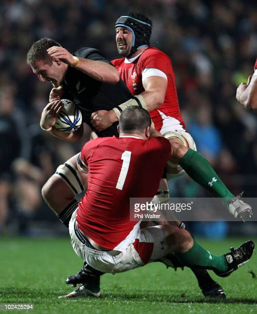 Kieran Read of the All Blacks is tackled by Paul James and Jonathan Thomas of Wales during the rugby test match between the New Zealand All Blacks...