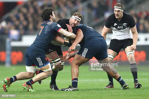 Kieran Read of the All Blacks is tackled during the international rugby match between France and New Zealand at Stade de France on November 26 2016...
