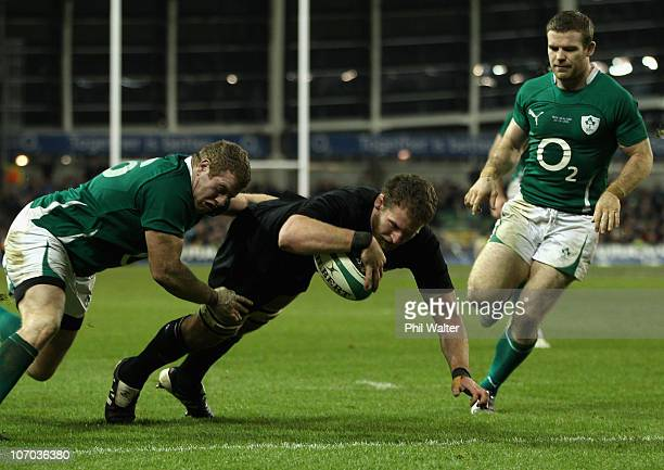 Kieran Read of the All Blacks scores a try in the tackle of Sean Cronin of Ireland during the Test match between Ireland and the New Zealand All...