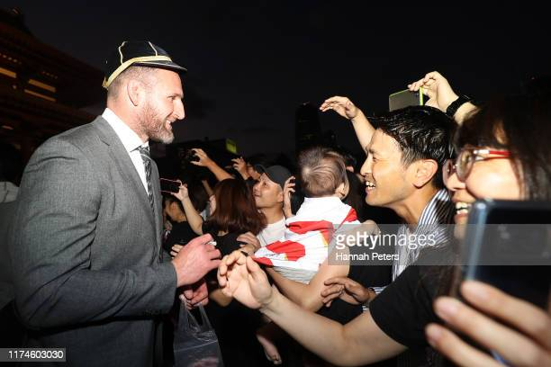 Kieran Read of the All Blacks signs autographs for fans during a New Zealand All Blacks Rugby World Cup Welcome Ceremony at Zojoji Temple on...