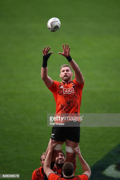 Kieran Read of the All Blacks takes the ball in the lineout during a New Zealand All Blacks training session at Forsyth Barr stadium on August 24,...