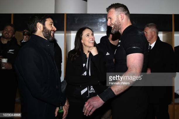 Kieran Read of the All Blacks talks with New Zealand Prime Minister Jacinda Ardern and her partner Clark Gayford in the dressing room after winning...