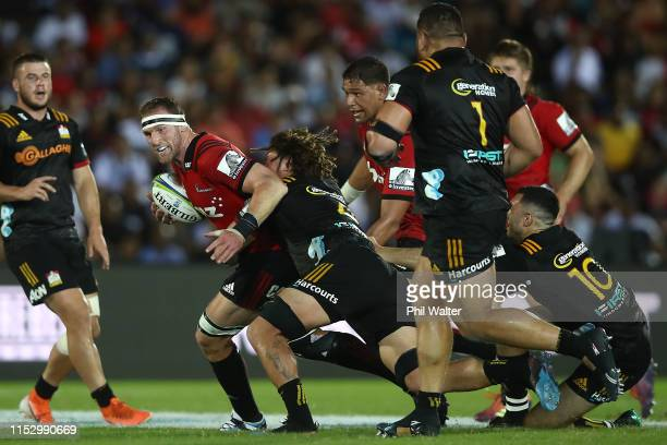 Kieran Read of the Crusaders is tackled during the round 16 Super Rugby match between the Chiefs and the Crusaders at the ANZ National Stadium on...