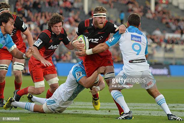 Kieran Read of the Crusaders is tackled during the round two Super Rugby match between the Crusaders and the Blues at AMI Stadium on March 4 2016 in...