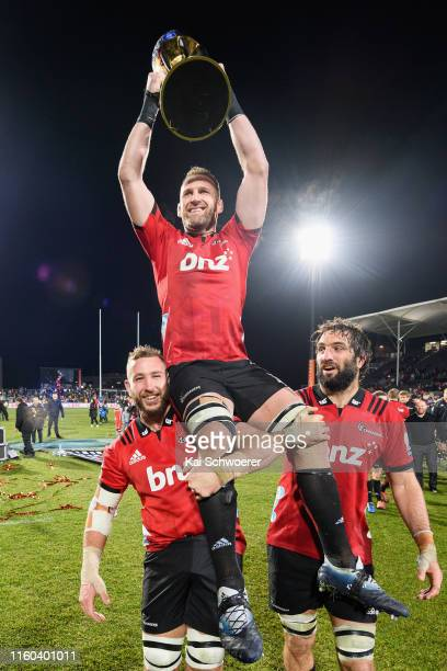 Kieran Read of the Crusaders lifts the Super Ruugb trophy after winning the Super Rugby Final between the Crusaders and the Jaguares at Orangetheory...