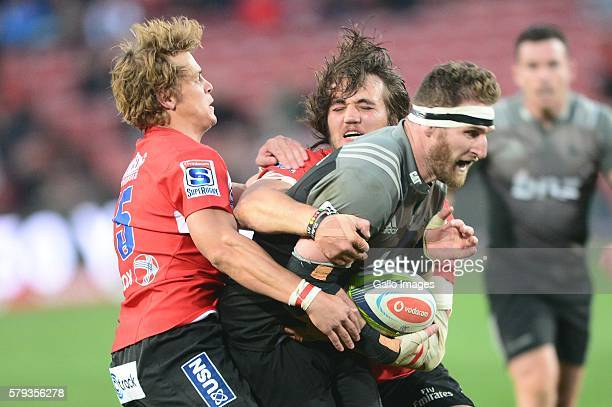 Kieran Read of the Crusaders tackled by Andries Coetzee of the Lions during the Super Rugby match between the Emirates Lions and Crusaders at...