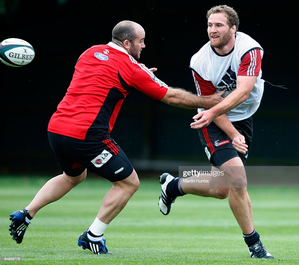 Kieran Read passes the ball as he is tackled by Jason McDonald during a Crusaders Super 14 training session at Rugby Park on February 16, 2009 in Christchurch, New Zealand.