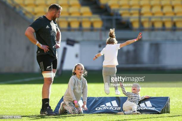 Kieran Read plays with children from left Elle Eden and Reuben during a New Zealand All Blacks Captain's Run at Westpac Stadium on September 14 2018...