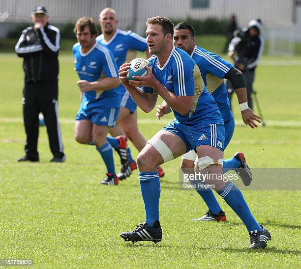 Kieran Read runs with the ball during a New Zealand All Blacks training session held at St George's College on September 25 2012 in Buenos Aires...