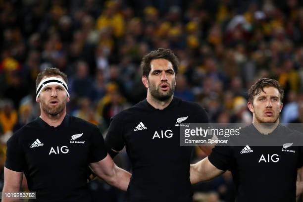 Kieran Read Sam Whitelock and Nathan Harris of the All Blacks sing the New Zealand national anthem during The Rugby Championship Bledisloe Cup match...