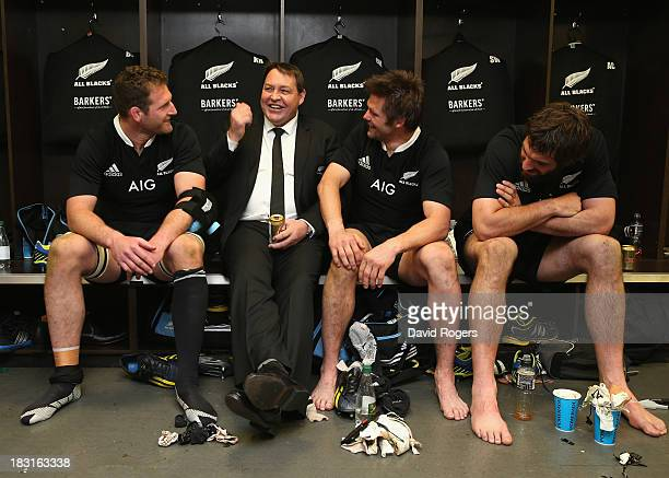 Kieran Read, Steve Hansen, the head coach, Richie McCaw, All Black captain and Sam Whitelock celebrate after their victory during the Rugby...