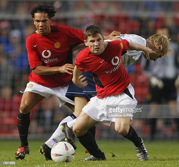Kieran Richardson and David Jones of Manchester United battle with Andrew Davies of Middlesbrough during the FA Youth Cup Final Second Leg match...