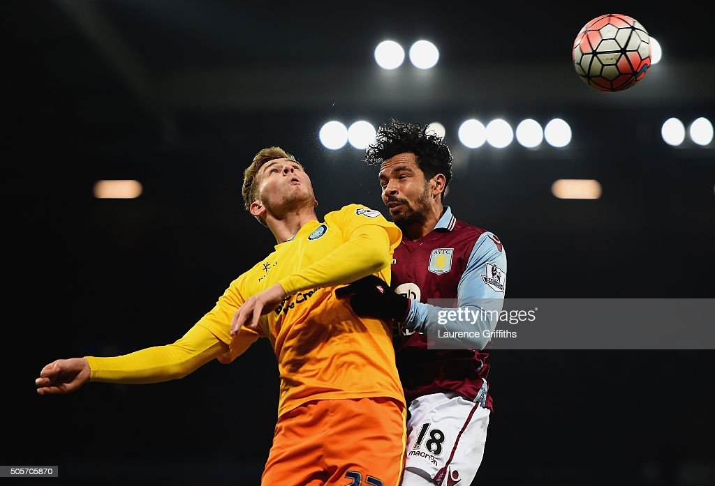 Kieran Richardson of Aston Villa and Jason McCarthy of Wycombe Wanderers compete for the ball during the Emirates FA Cup Third Round Replay match between Aston Villa and Wycombe Wanderers at Villa Park on January 19, 2016 in Birmingham, England.