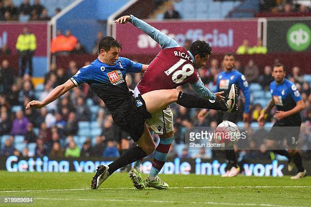 Kieran Richardson of Aston Villa and Tommy Elphick of Bournemouth compete for the ball during the Barclays Premier League match between Aston Villa...