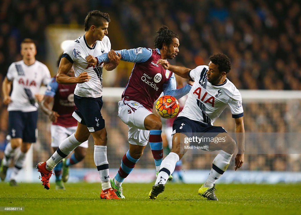 Kieran Richardson of Aston Villa goes between Erik Lamela (L) and Mousa Dembele of Tottenham Hotspur (R) during the Barclays Premier League match between Tottenham Hotspur and Aston Villa at White Hart Lane on November 2, 2015 in London, England.