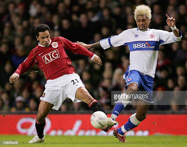 Kieran Richardson of Manchester United clashes with Abel Xavier of Middlesbrough during the FA Cup Sponsored by EON QuarterFinal Replay match between...