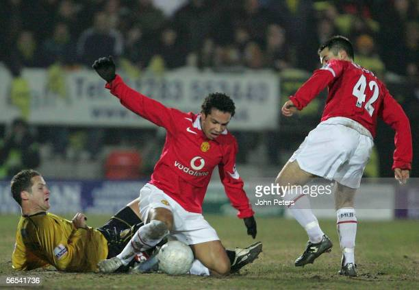 Kieran Richardson of Manchester United clashes with Jake Sedgemore of Burton Albion during the FA Cup Third Round match between Burton Albion and...