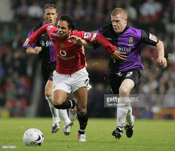 Kieran Richardson of Manchester United clashes with Nicky Bailey of Barnet during the Carling Cup third round match between Manchester United and...