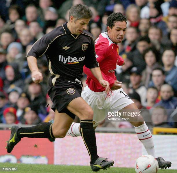 Kieran Richardson of Manchester United clashes with Scott Hiley of Exeter City during the FA Cup match between Manchester United and Exeter City at...