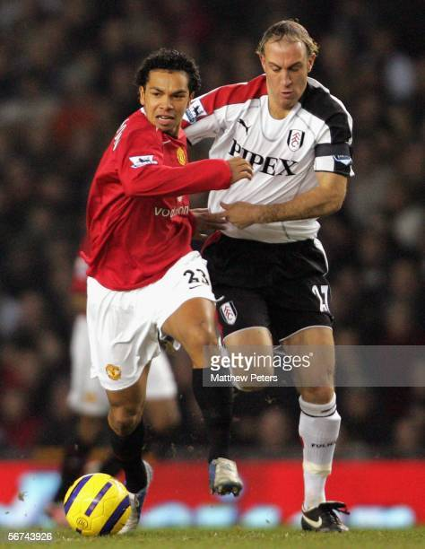 Kieran Richardson of Manchester United clashes with Simon Elliott of Fulham during the Barclays Premiership match between Manchester United and...