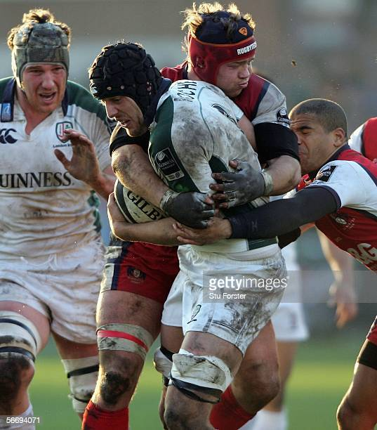 Kieran Roche of London Irish is tackled by Jake Boer of Gloucester during the Guinness Premiership match between Gloucester and London Irish on...