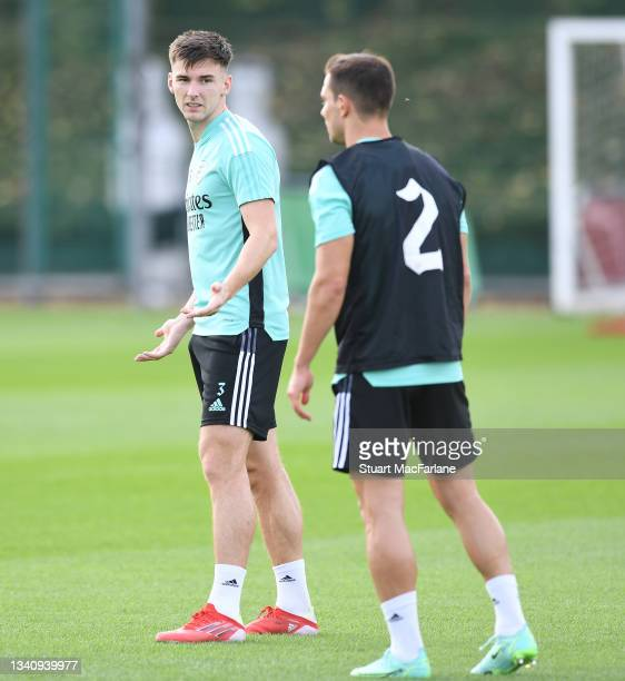 Kieran Tierney and Cedric of Arsenal during a training session at London Colney on September 17, 2021 in St Albans, England.