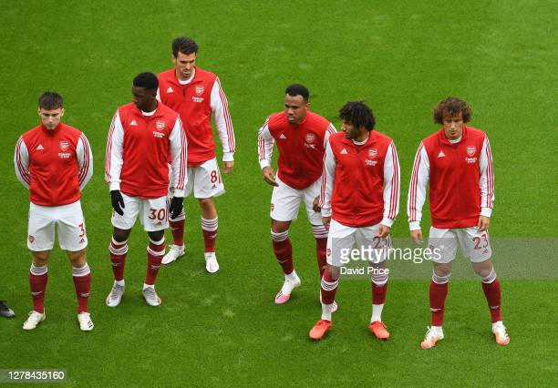Kieran Tierney Eddie Nketiah Dani Ceballos Gabriel Magalhaes Mohamed Elneny and David Luiz of Arsenal line up before the Premier League match between...