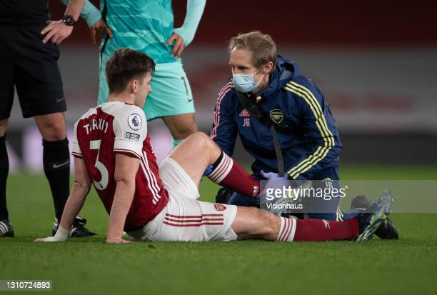 Kieran Tierney is treated by Arsenal medical staff before being substituted during the Premier League match between Arsenal and Liverpool at Emirates...