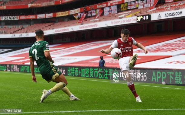 Kieran Tierney of Arsenal and George Baldock of Sheffield United during the Premier League match between Arsenal and Sheffield United at Emirates...