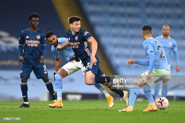 Kieran Tierney of Arsenal battles for possession with Riyad Mahrez and Joao Cancelo of Manchester City during the Premier League match between...