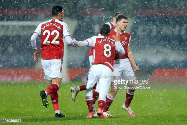 Kieran Tierney of Arsenal celebrates scoring the opening goal with Pablo Mari and Dani Ceballos during the Premier League match between West Bromwich...