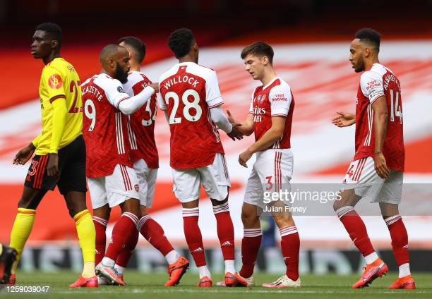 Kieran Tierney of Arsenal celebrates with teammate Joe Willock after scoring his sides second goal during the Premier League match between Arsenal FC...