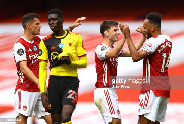 Kieran Tierney of Arsenal celebrates with teammate PierreEmerick Aubameyang after scoring his sides second goal during the Premier League match...