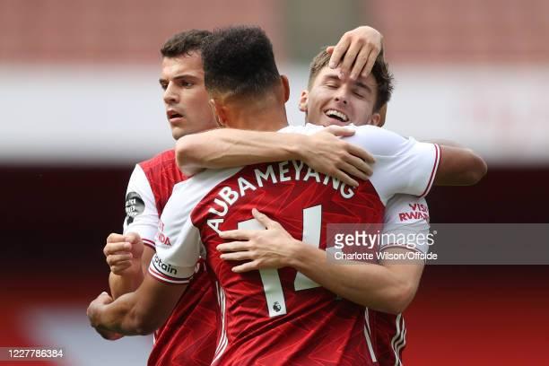 Kieran Tierney of Arsenal celebrates with teammates Granit Xhaka of Arsenal and PierreEmerick Aubameyang of Arsenal after scoring their 2nd goal...