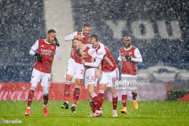 Kieran Tierney of Arsenal celebrates with teammates Pierre-Emerick Aubameyang, Pablo Mari and Rob Holding after scoring their team's first goal...